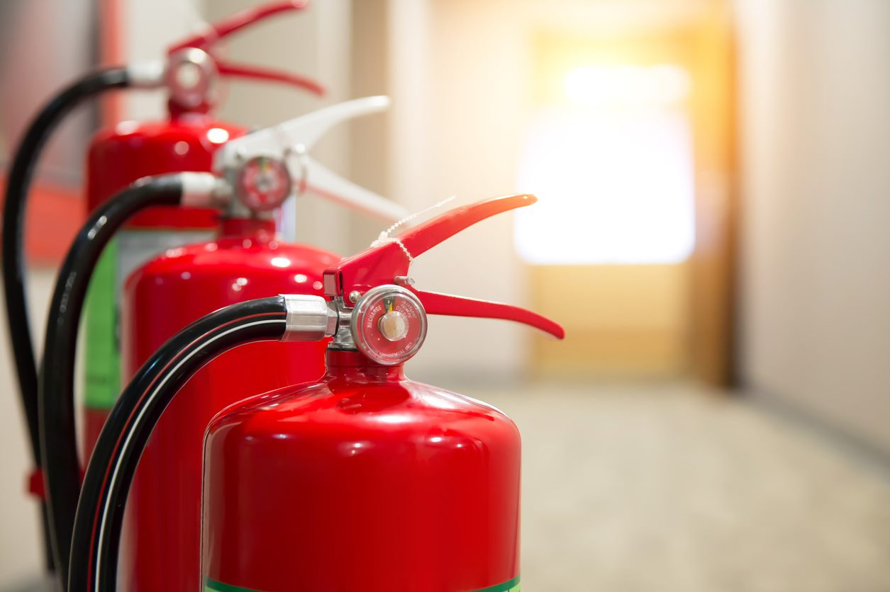 different types of fire extinguishers lined up