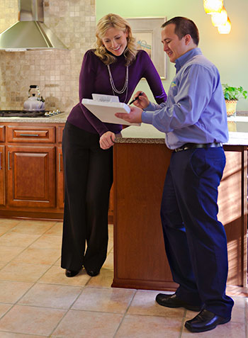 Homeowner and technician discussing flexserv options