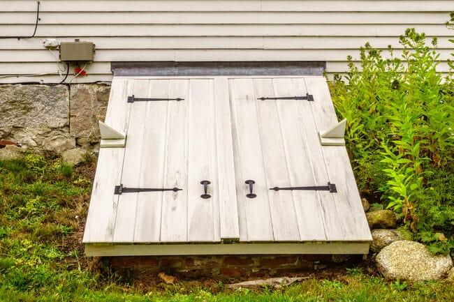 door to tornado shelter in basement of home