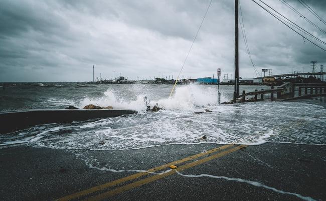 coastal flood damaging homes on coast