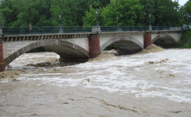 river flood overflowing near bridge