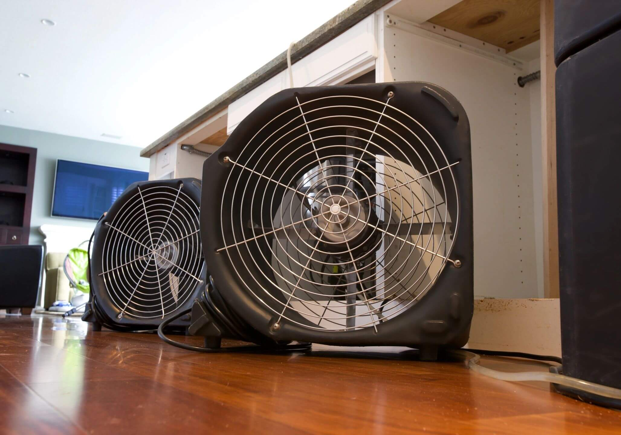 industrial fans drying out water damage inside a home