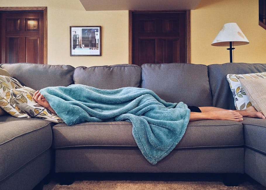 person laying on couch sick