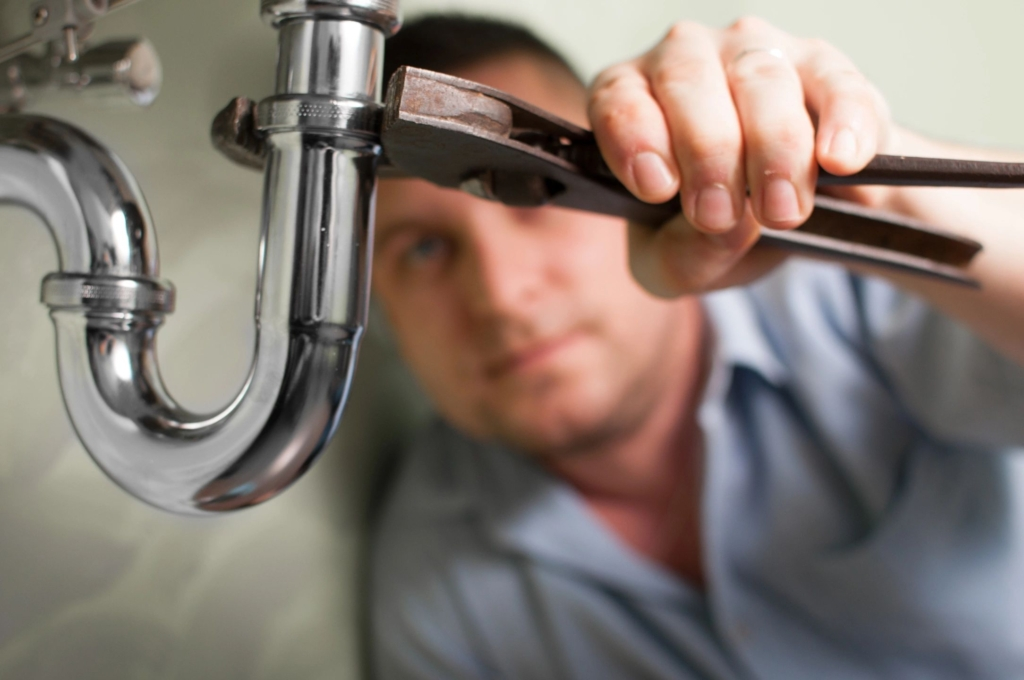 Man fixing a sink pipe
