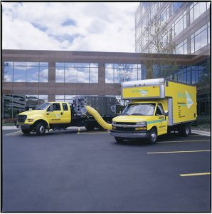 ServiceMaster trucks outside an office building