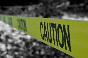 Caution yellow police tape