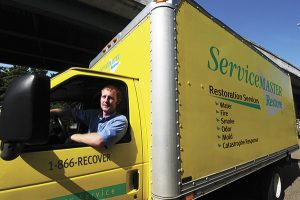 Man sitting in a Servicemaster truck