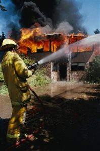 Firefighter putting out a home fire