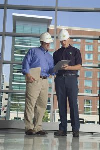 Two men in construstion hats