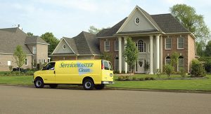 Servicemaster truck outside a home