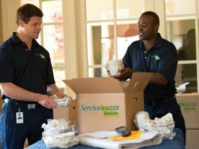 ServiceMaster technicians packing a box