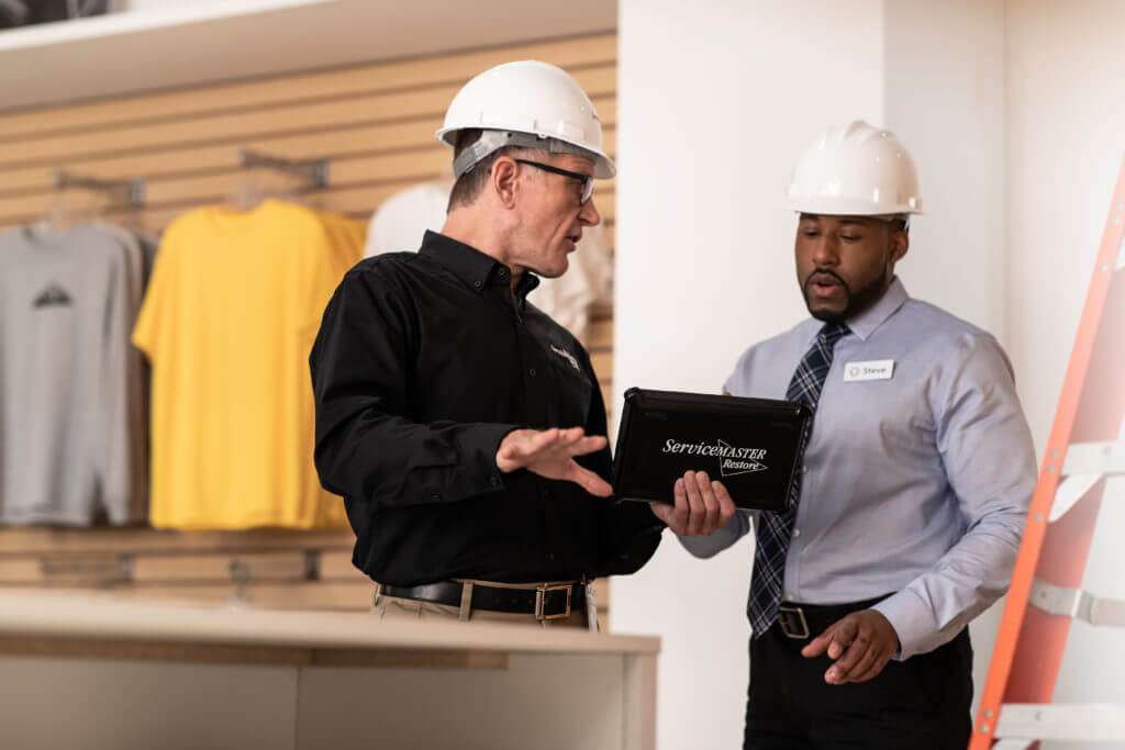 Consultation between business owner and ServiceMaster Restore technician
