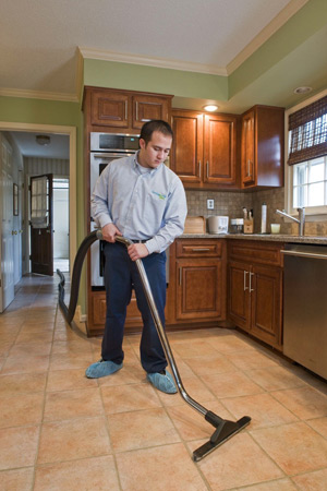 Man cleaning a tile floor