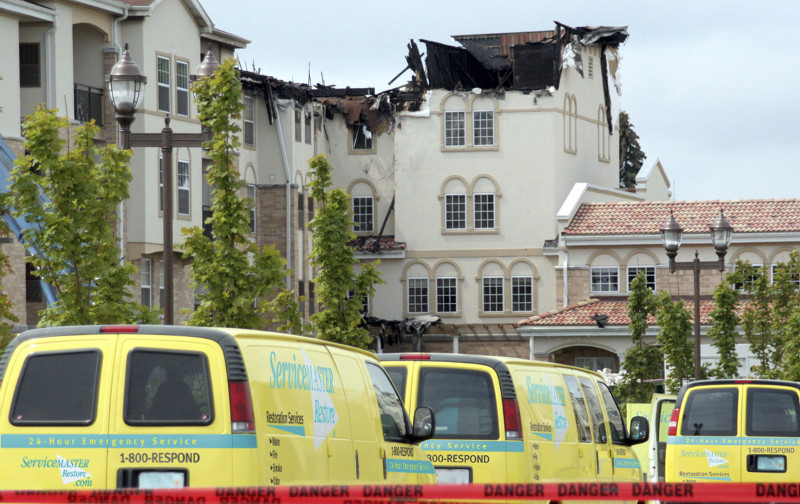 ServiceMaster vans outside of fire damage