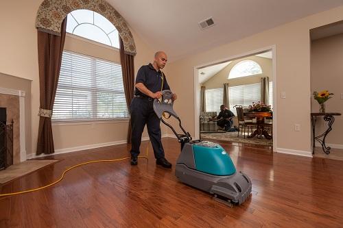 man cleaning wooden floor