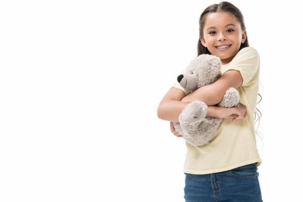 Little girl holding a teddy bear