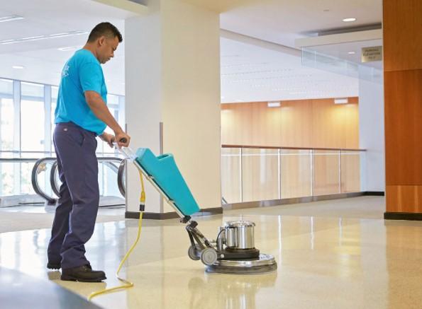 Man waxing floor