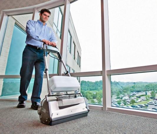 Man Using Machine to clean carpet