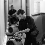 man working with a servicemaster fan