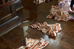 rags soaking up water on wood floor