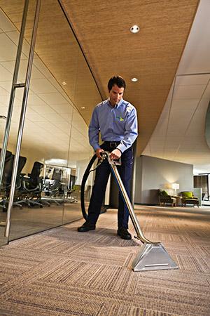 Man vacuuming a floor
