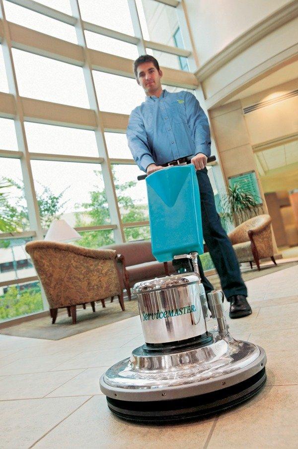 Man waxing a floor