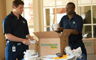 ServiceMaster Employees packing a box