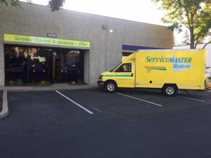 ServiceMaster truck outside of a building