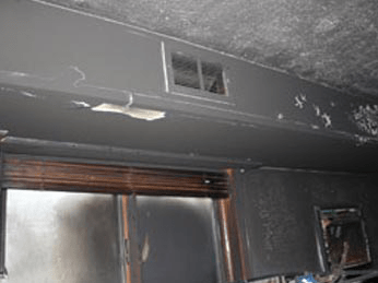Smoke damaged ceiling and vent