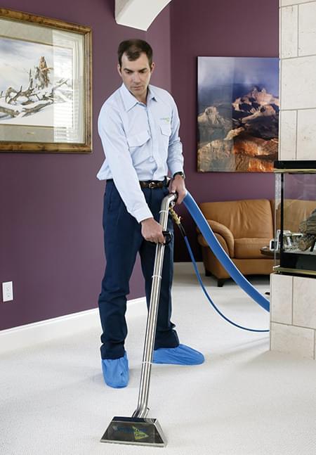 Man Vacuuming a carpet