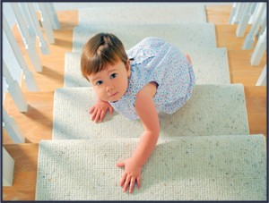 baby on carpeted stairs