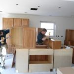 Man fixing cabinets
