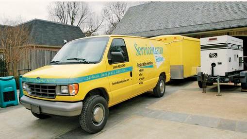 Yellow ServiceMaster truck