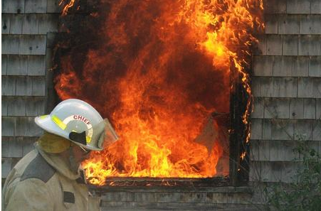 firefighter putting out a fire