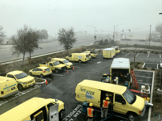 servicemaster trucks and workers