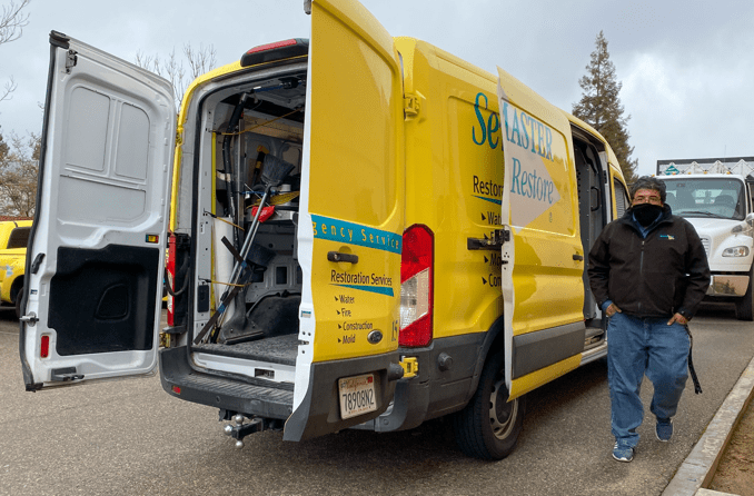 Servicemaster truck and employee